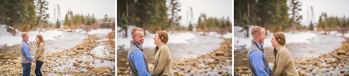 Couple poses in the snow for engagement photos in Keystone Colorado