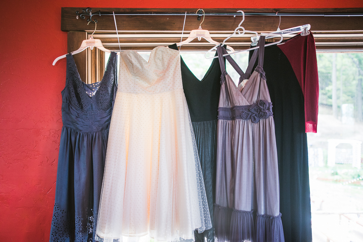 wedding and bridesmaid dresses hanging in window