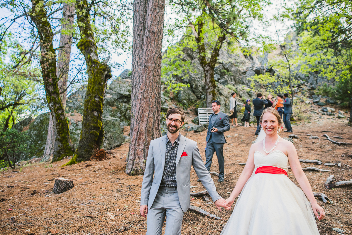 bride and groom walking down path in mendocino