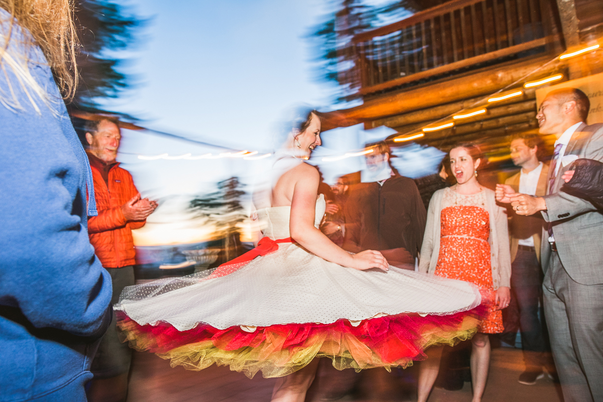bride with colorful dress twirling