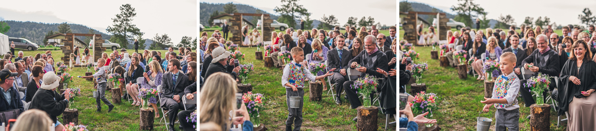 ring bearer walks down aisle in estes park colorado