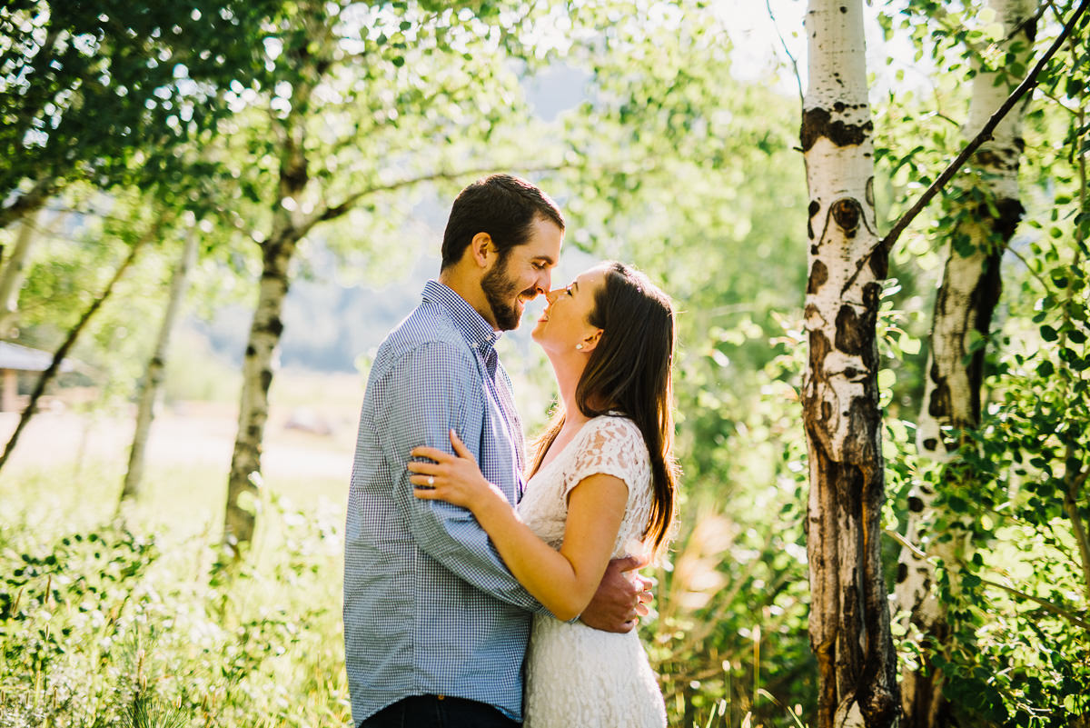 Couple pose for enagement photos near Estes park