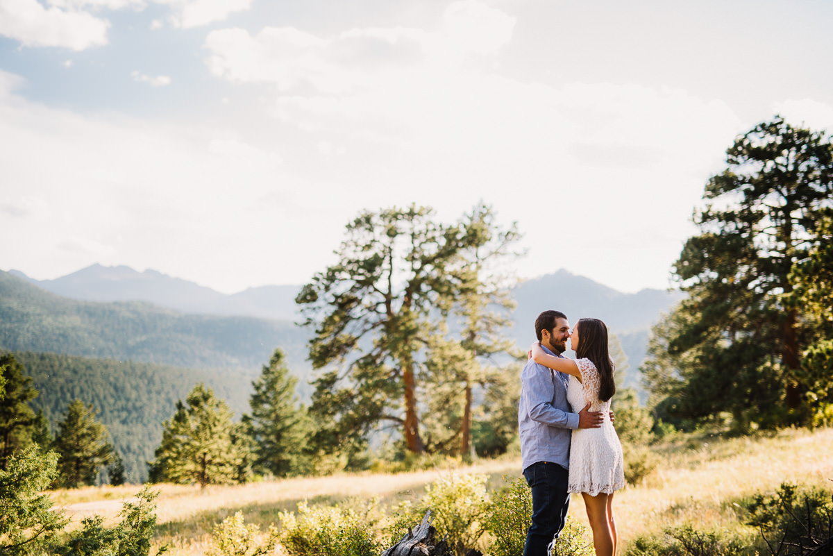 couple hugging near the mountains in hermit park