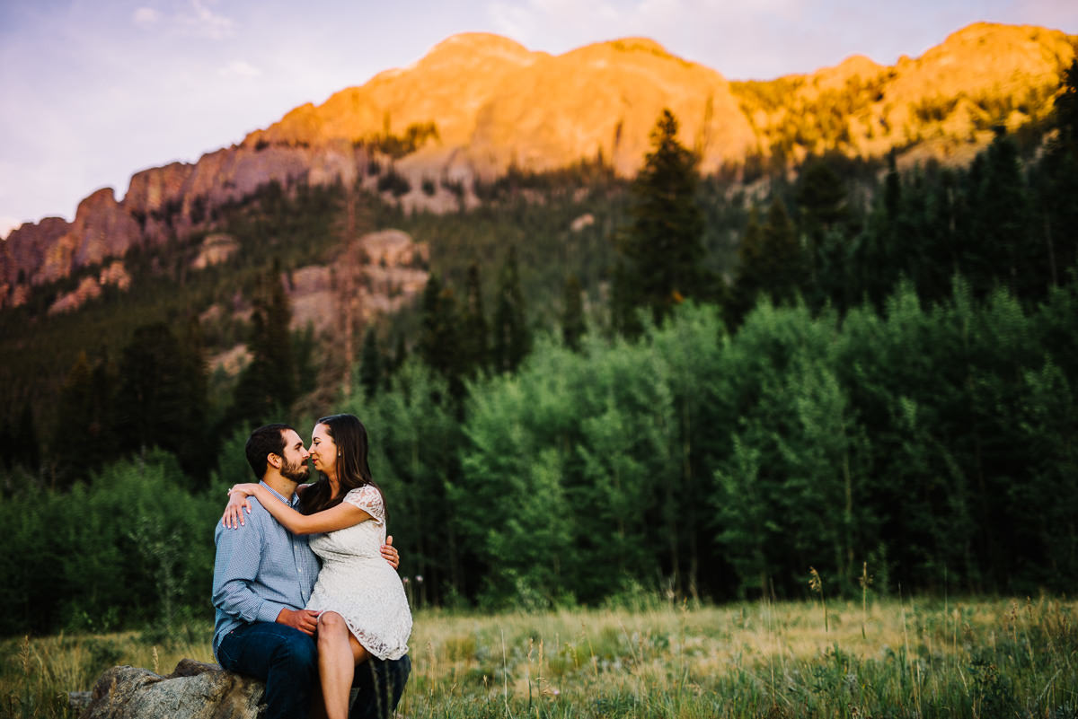 Couple pose for engagement photos at lily Lake
