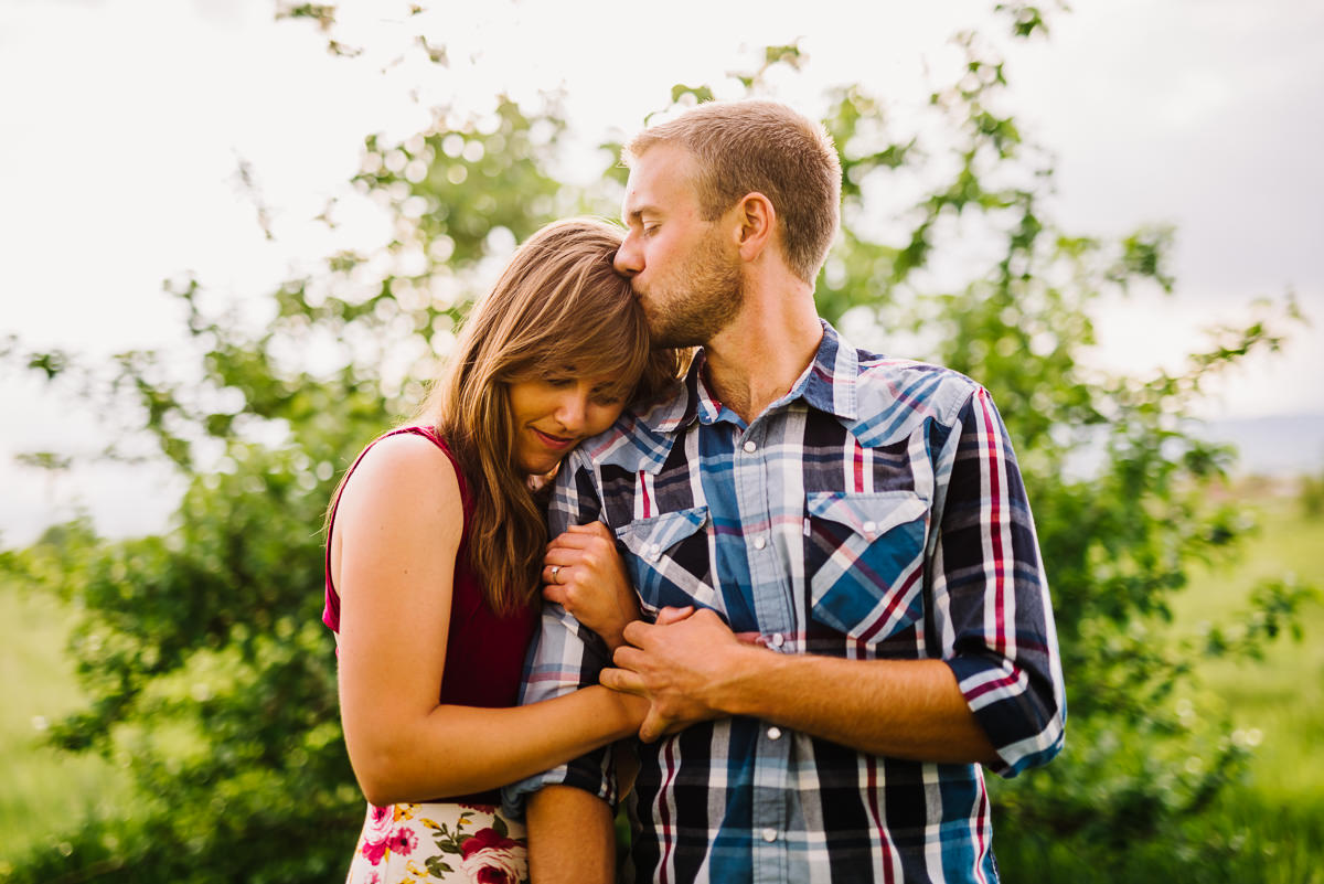 couple poses for engagement photo at crown hill sanctuary
