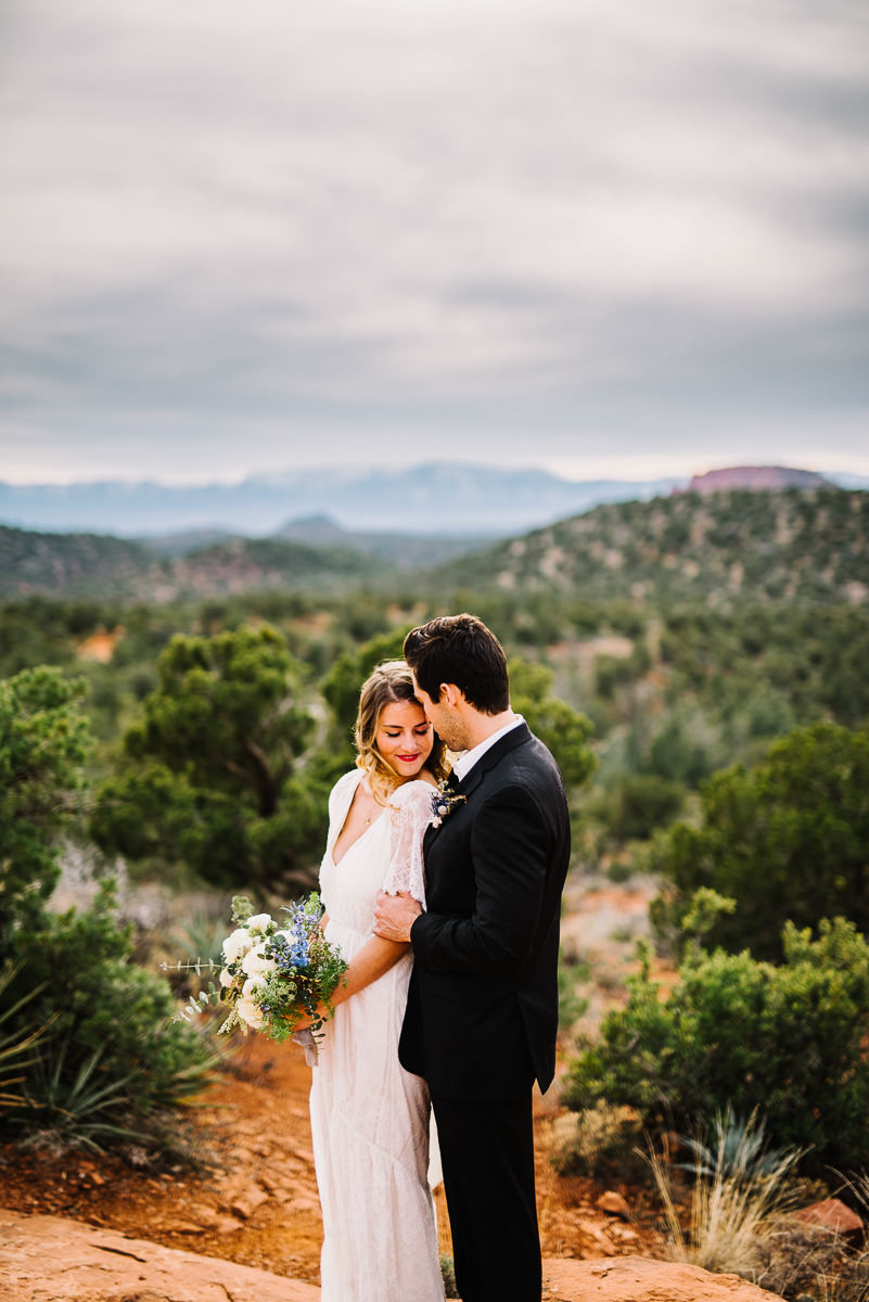 Bride and groom share intimate moment in Sedona Arizona