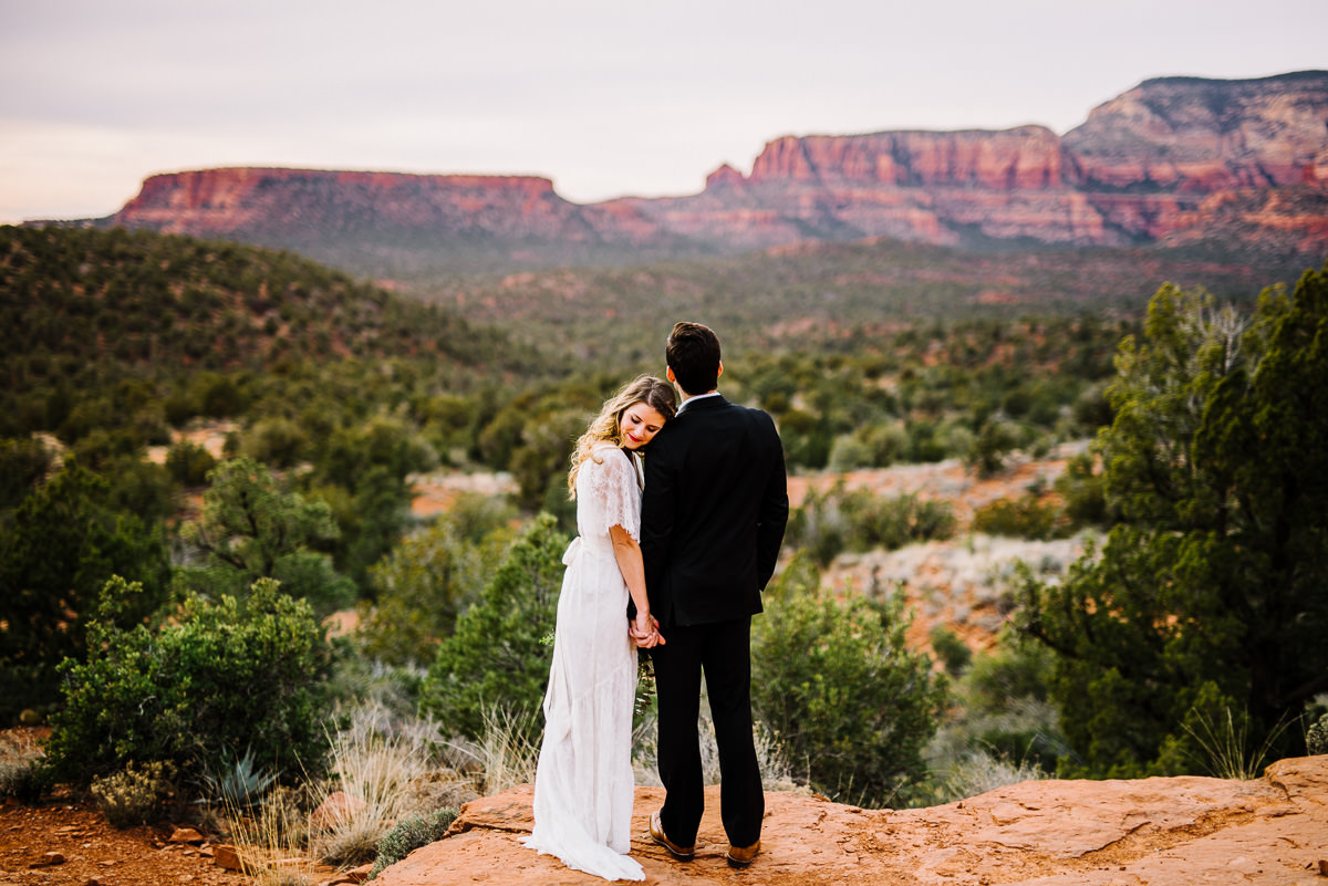 vintage bride and groom pose during sedona wedding