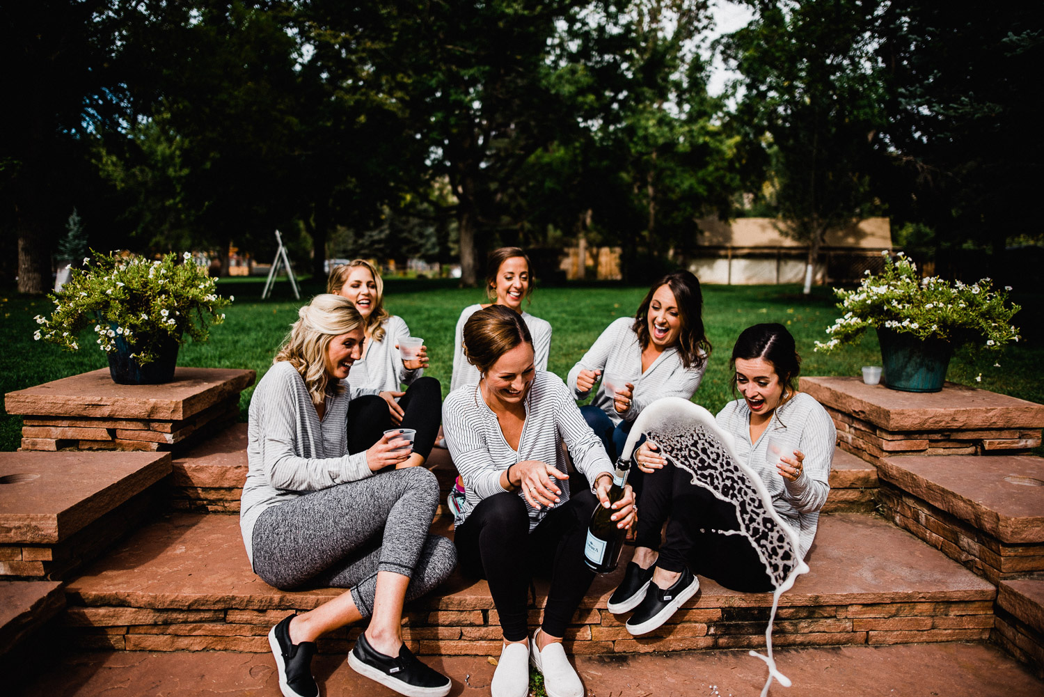 bridal party popping champagne cork in lyons colorado