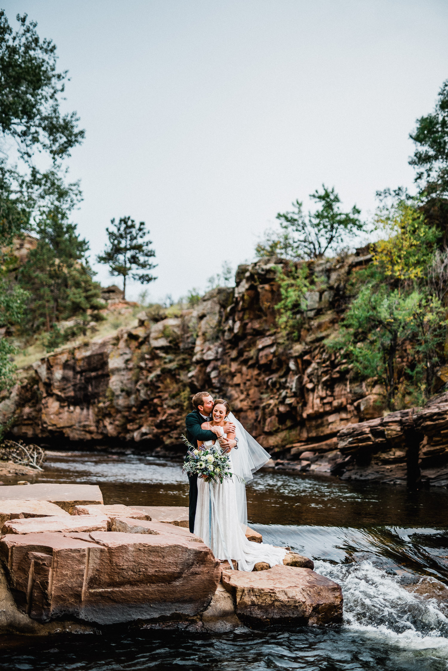 wedding portrait on the river at the river bend in lyons colorado