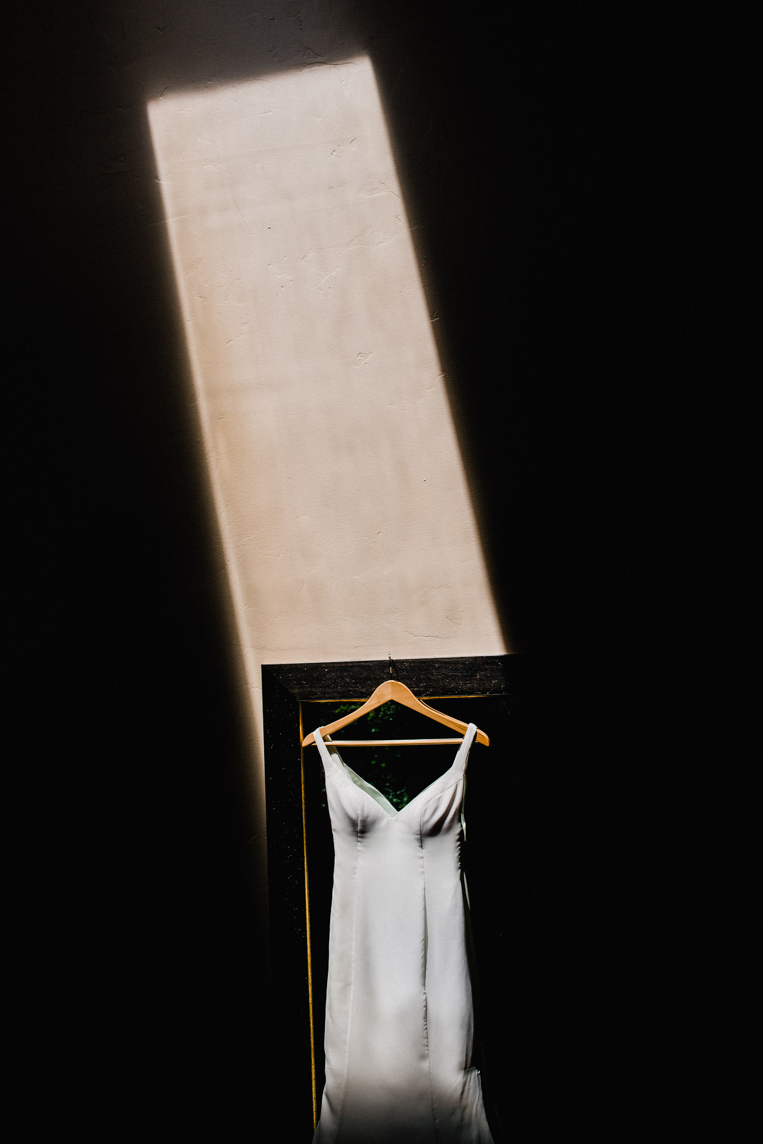 artistic photo of a wedding dress in dramatic lighting