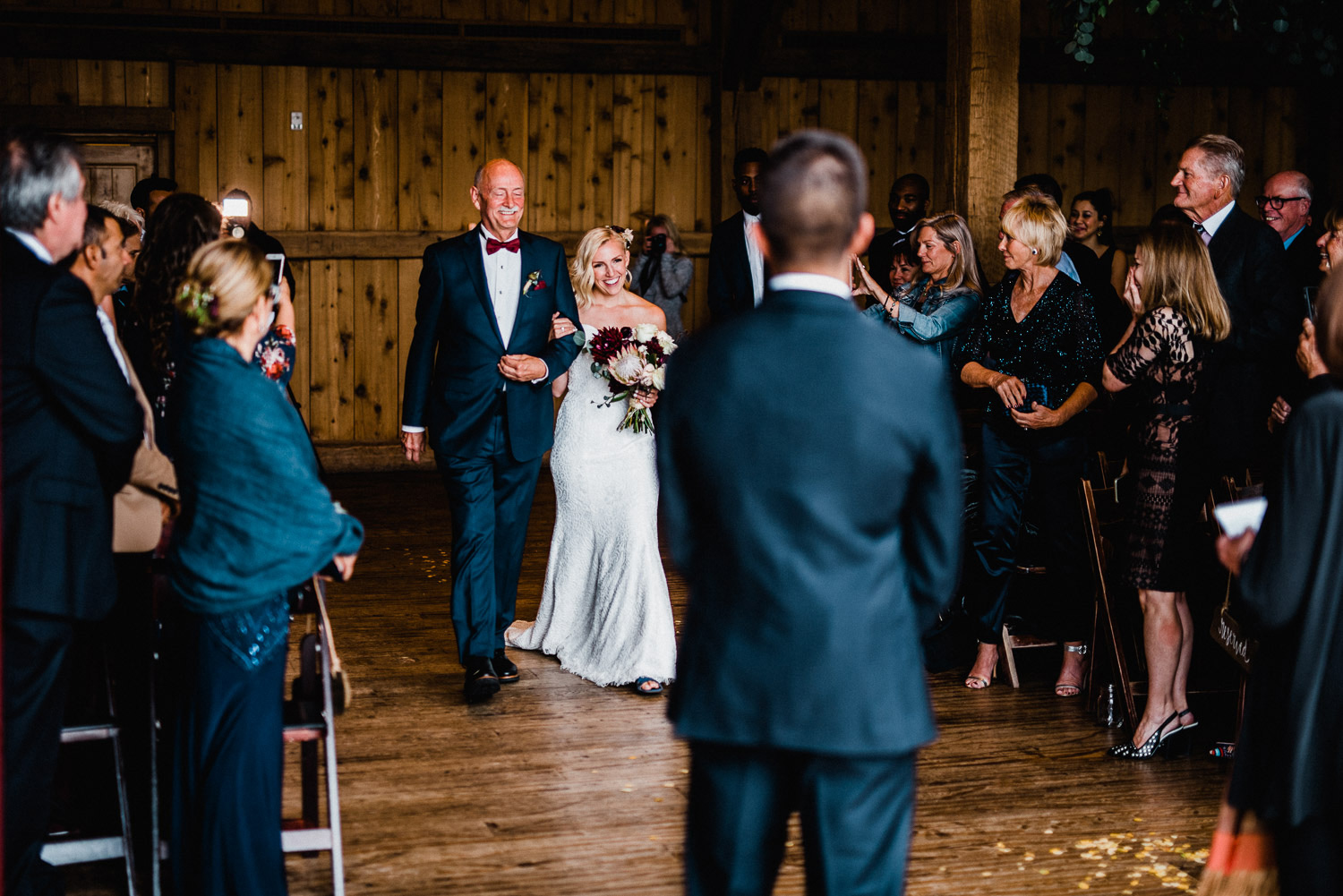bride walks down aisle at devil's thumb ranch