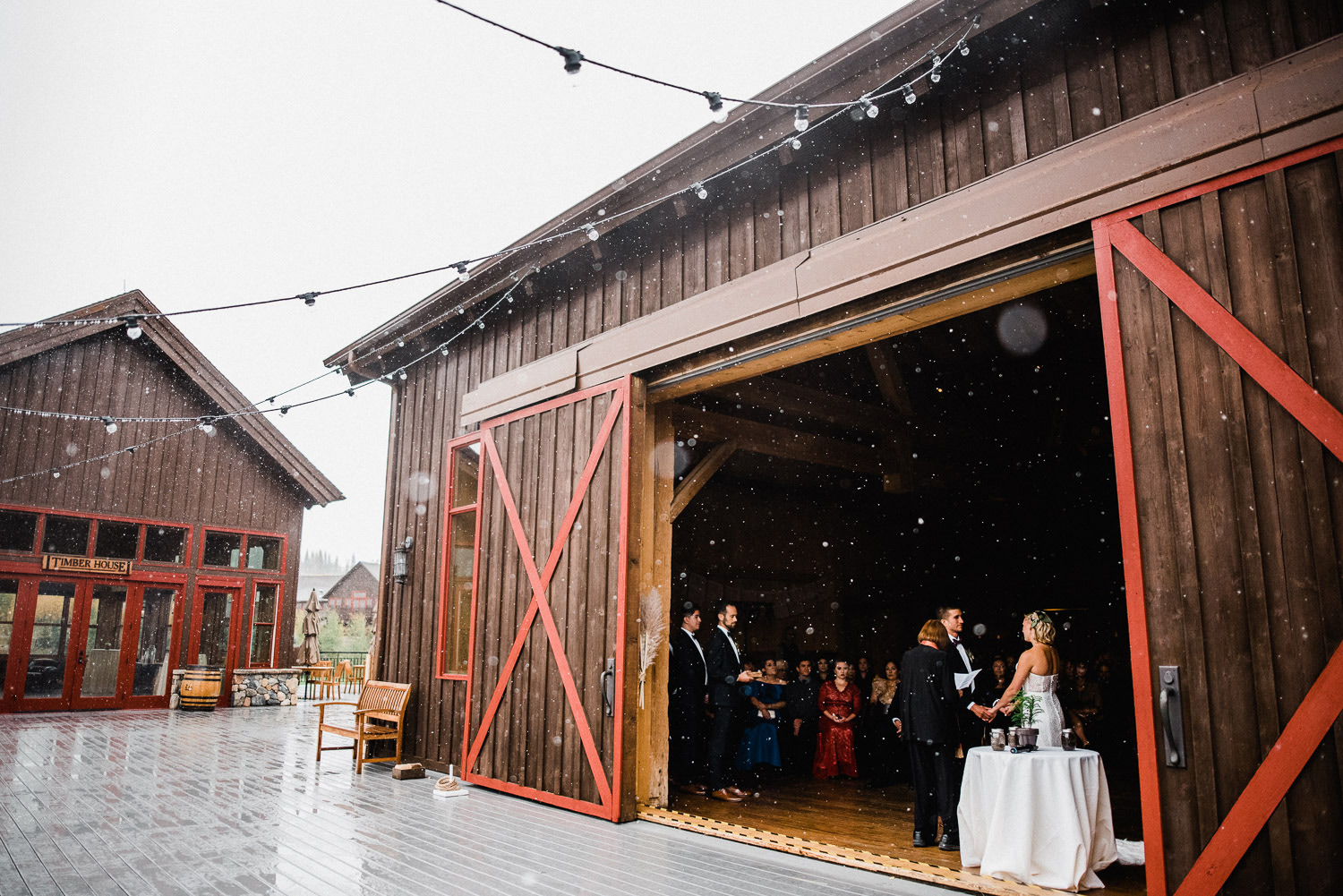 snowy wedding ceremony at devil's thumb ranch in colorado